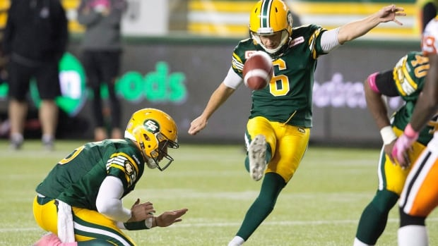 Edmonton Eskimos' Sean Whyte (6), right, kicks a field goal against the B.C. Lions in October.