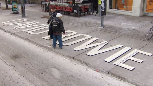 A Toronto street artists painted this tribute to the late David Bowie on Queen Street West, near Spadina Avenue.
