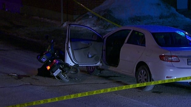 The driver of a scooter died after hitting an open car door and getting pinned under a passing pickup truck in the ByWard Market on Jan. 11, 2016.
