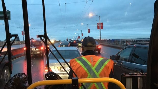 A passenger waits on a bus as the Granville Bridge was closed in both directions due to a police incident.