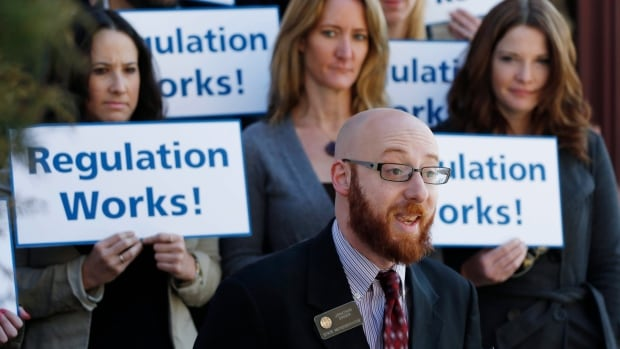 State Representative Jonathan Singer speaks at a pro-legalization rally in Denver. The state of Colorado had its first legal sale of marijuana in January 2014.
