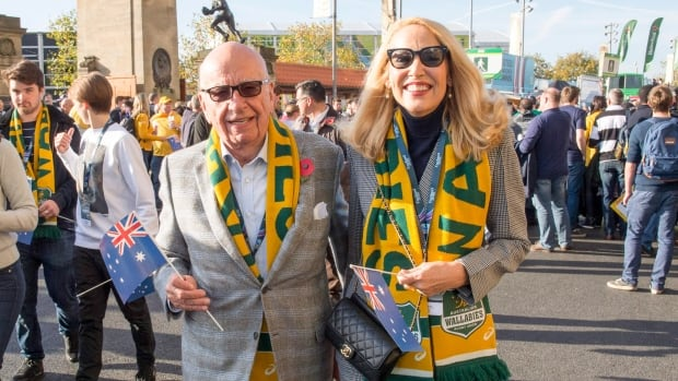 News Corp Executive Chairman Rupert Murdoch is shown arriving with model Jerry Hall for the Rugby World Cup final on Oct. 31, 2015.