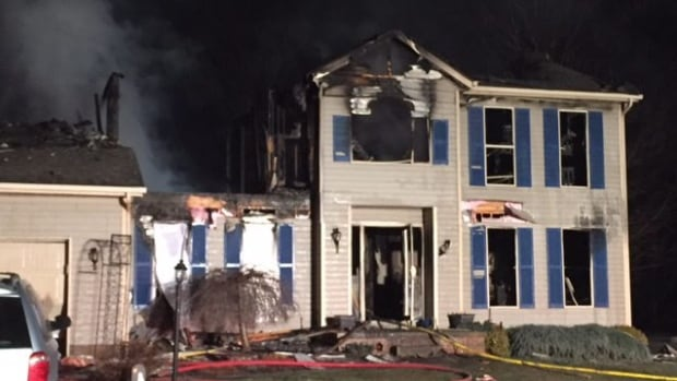 Authorities respond after a deadly house explosion Monday night in Northfield Center Township in Summit County, Ohio.
