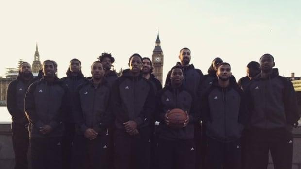 The Toronto Raptors pose with Big Ben in London, England.