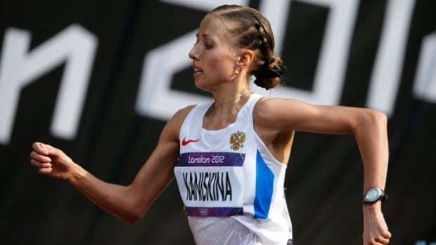 Race walker Olga Kaniskina's gold was one of 13 medals won by Russian athletes at the 2009 track and field world championships. According to The Associated Press, those medals came at a time when the sport's governing body was warning Russia about suspicious samples from its athletes.
