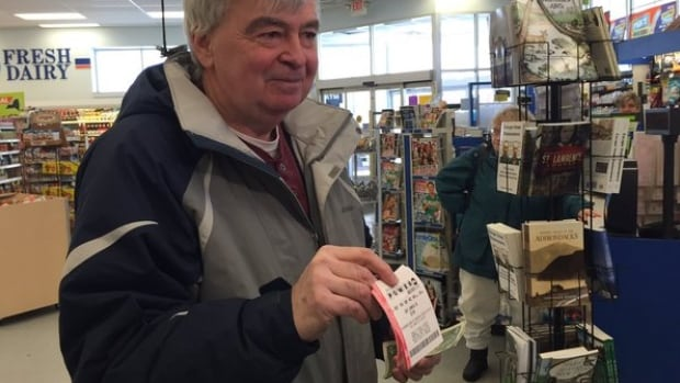 Terry Lee, from Perth, Ont., shows off his Powerball tickets.