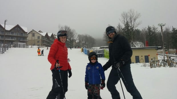 Sally Green and Marc Delesclefs with Theo, 6, skiing in Bromont while Hugo, 4, is at a skiing lesson.