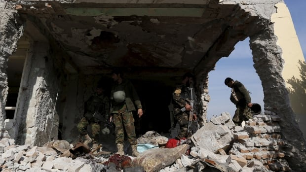 Afghan National Army soldiers inspect a damaged building after an attack on Pakistan's consulate in Jalalabad, Afghanistan, on Wednesday.