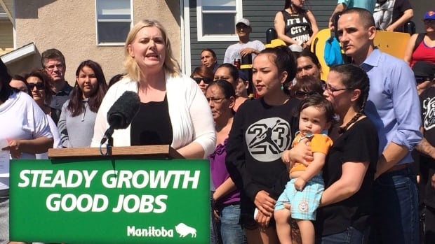 Manitoba Family Services Minister Kerri Irvin-Ross (centre) and Jobs and the Economy Minister Kevin Chief (right, blue shirt) announce increased housing subsidies on May 22, 2015. Asper School of Business dean Michael Benarroch says government spending is a major driver of economic growth in Manitoba.
