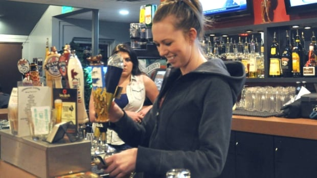 Bartender Jasmine Gilbert pours a pint at Lynwood Station pub, a favourite haunt for thirsty Ogden locals.