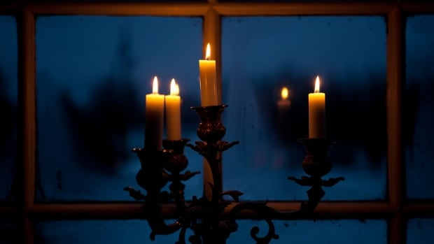 Candles in Window at Night