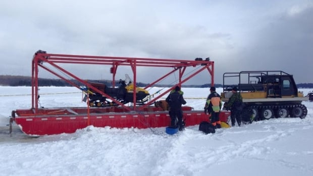 """This piece of equipment is known as """"Big Red,"""" which Pierre Lafond uses to pull snowmobiles out of ice and water."""