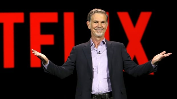 Reed Hastings, co-founder and CEO of Netflix, gives a presentation at the Consumer Electronics Show in Las Vegas. The streaming service says it's making progress in licensing content across borders.