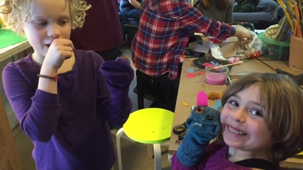 Elsie Jefferies, left, and Bridget Gray are both seven years old and like making sock puppets at the free art studio.