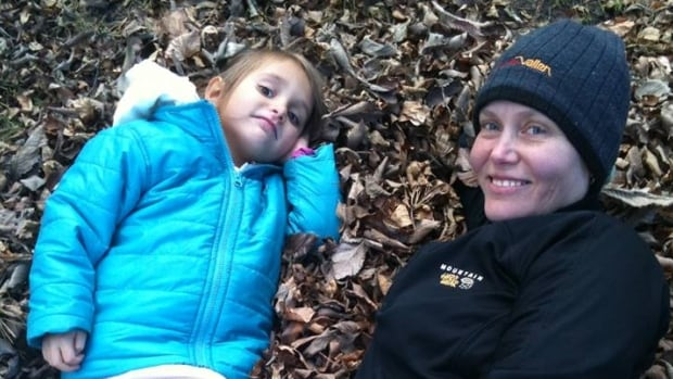 Malin Hansen and her 3-year-old daughter Nora enjoying the leaves in Wascana Park.