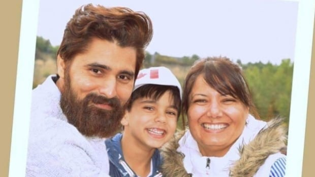 Karanpal Bhangu, 35, killed while working at a Mac's convenience store Dec. 18, was laid to rest on Thursday. He is shown with his son Royce and his wife Kiran in this image from the GoFundMe website.