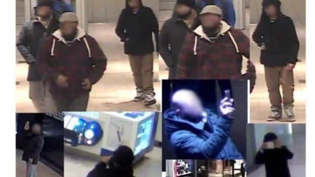 "CBC originally published this photo showing the faces of men seen taking video and pictures at Pacific Centre mall on Jan. 12, 2016. Vancouver police have established the men's actions were ""completely innocent."" CBC has decided to no longer identify them."