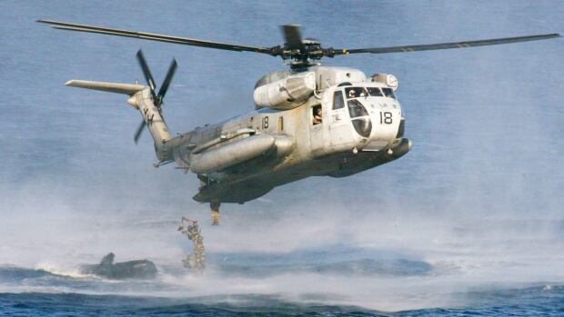U.S. Marines and their Philippine counterparts jump from a U.S. Marine CH-53D Sea Stallion helicopter in this 2003 file photo. The U.S. Coast Guard said Friday two Marine helicopters have collided off the Hawaiian island of Oahu.