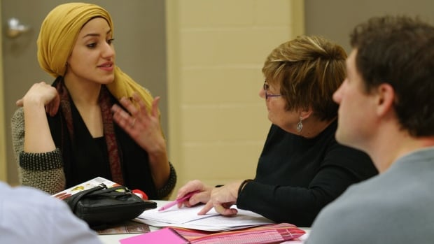 Zainab Ramahi, a co-ordinator with Muslim Social Services, helps one of the students with pronunciation at the Arabic crash course.