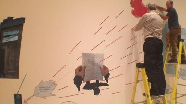 Artist Mathew Reichertz sets up his exhibition Garbage at the Carleton University Art Gallery.