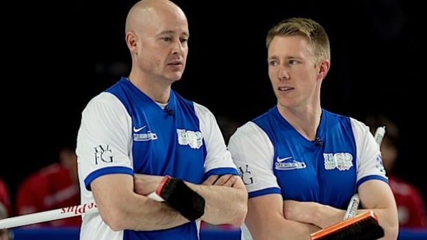Kevin Koe and Marc Kennedy of Team North America discuss strategy Friday in Las Vegas but they lost their match in the final end as Team World regained the lead in the Continental Cup, 10 points to 8.