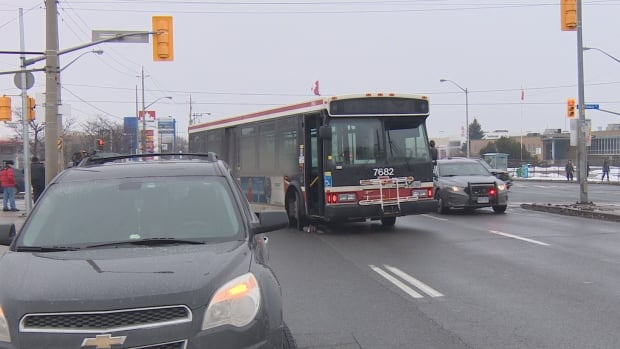 Police tell CBC News the woman was hit by a bus on Friday afternoon, and was swept underneath the vehicle.