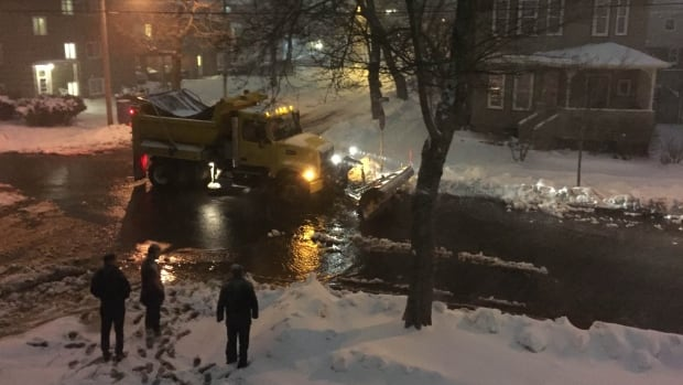 Saturday night a snow plow pushed excess water into storm drains at Atlantic Street and McLean Street, a block east of Young Avenue in Halifax's south end.