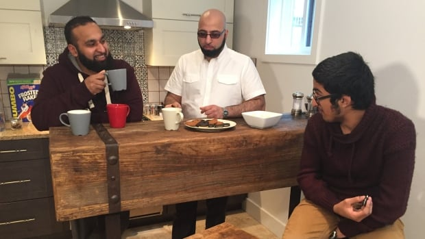 Mohammed Sharaz (left) says he has 'no complaints' with the public's reaction following the intense interest in what he, his friend Mohammed Kareem (centre) and his son (right) were doing photographing Pacific Centre.