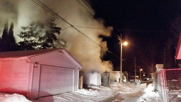 Smoke fills the air in the 3100 block of Winnipeg's Ness Avenue.