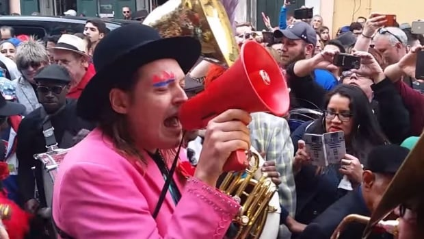 Arcade Fire frontman Win Butler belts out Heroes during the band's David Bowie memorial parade in New Orleans Saturday.