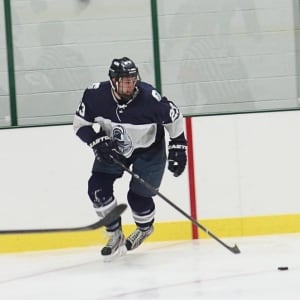 Matthew Hutchinson playing hockey with the Geneseo Knights
