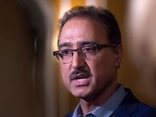 Infrastructure Minister Amarjeet Sohi speaks with reporters after giving a lunch-hour speech at the Toronto Region Board of Trade on Thursday.