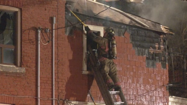 Hamilton firefighters rescued a 35-year-old man from a second-storey window during the multiple-alarm fire.