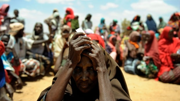A newly arrived elderly Somali woman waits with other new arrivals to be registered as refugees in Doolow, south western Somalia. Doolow is the main exit point for Somalis from Bay, Bakool and Gedo regions fleeing to Ethiopia to escape war and a severe drought ravaging the country.