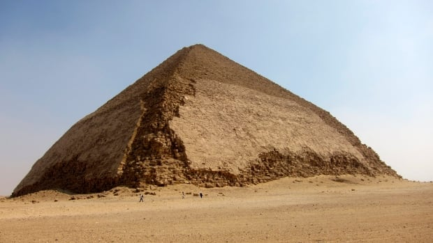 Tourists as they leave the Bent Pyramid at Dahshur, about 25 miles south of Cairo, Egypt, in 2011. An international heritage research group says scientists will begin analyzing radiographic muons, or cosmic particles, collected from the ancient Bent Pyramid built by the Pharaoh Snefru.