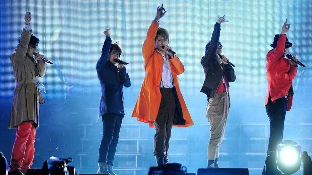 Longtime Japanese pop group SMAP (from left: Goro Inagaki, Takuya Kimura, Shingo Katori, Tsuyoshi Kusanagi, Masahiro Nakai), seen performing in Beijing in 2011, has dispelled rumours that it is disbanding.