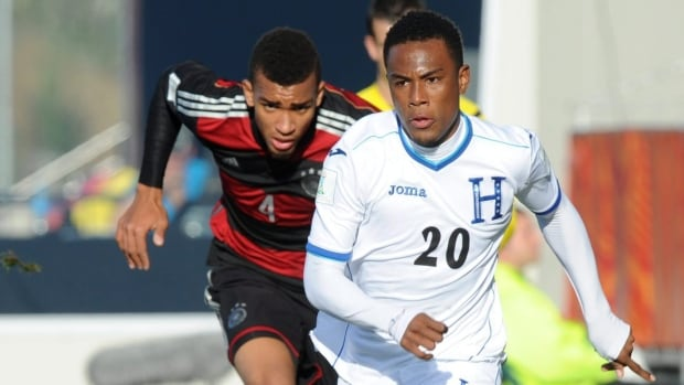 Deybi Flores of Honduras, shown at right in this 2015 file photo, has been signed to a multi-year deal with the Vancouver Whitecaps.