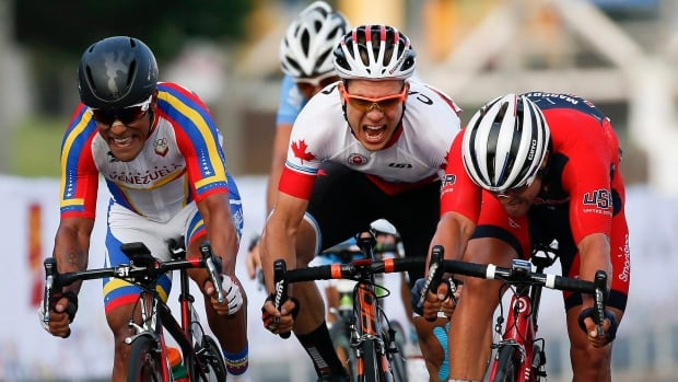 Canada's Guillaume Boivin, centre, won bronze in the men's road race cycling final at the Pan Am Games in Toronto.