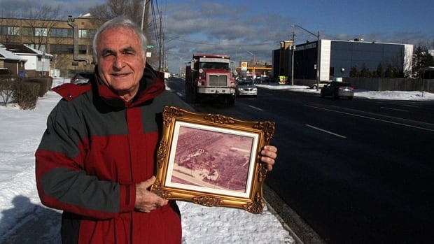 Standing on the narrow boulevard in front of his Centennial Parkway home, Fred Pizzoferrato shows a photo of what the area was like when he moved there in 1950. In the 1980s, he put an addition on the back of his house to get away from traffic noise. Now, he says, volumes are worse than ever.