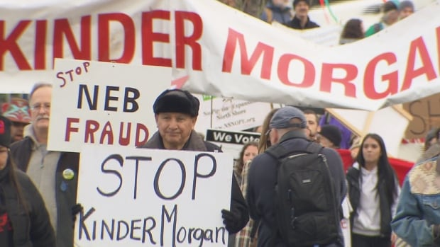 Grand Chief Stewart Phillip of the Union of B.C. Indian Chiefs leads a protest against expansion of the Kinder Morgan Trans Mountain pipeline on Jan. 19, while National Energy Board hearings continue in Burnaby.