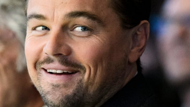 Actor Leonardo DiCaprio, foreground, reacts during the Crystal Award Ceremony on the eve of the opening of the 46th Annual Meeting of the World Economic Forum in Davos, Switzerland, Tuesday.