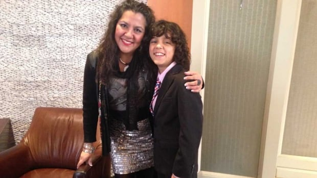 Winnipeg mother Eugenia Lehmann, left, with her son Keenan, 11. She says while her son is too old to benefit from a Spanish bilingual program, she is thrilled others will have the opportunity.