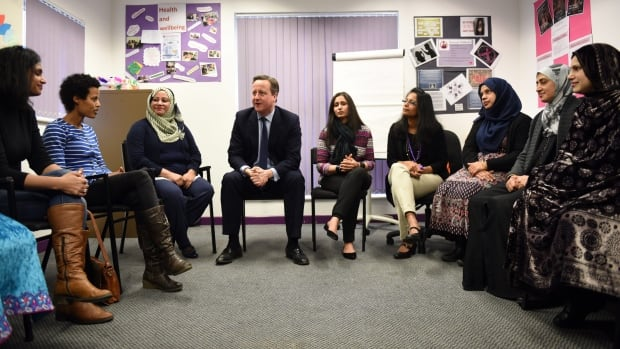 Britain's Prime Minister David Cameron meets women attending an English class after announcing his government would set up a new fund aimed at helping Muslim women improve their language abilities. But he drew criticism for linking their ability to speak English with the fight against extremism.