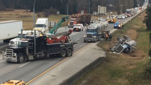 Highway 1 westbound in Langley has been reopened after it was closed for a rolled tanker truck, but motorists are still being told to expect major delays.