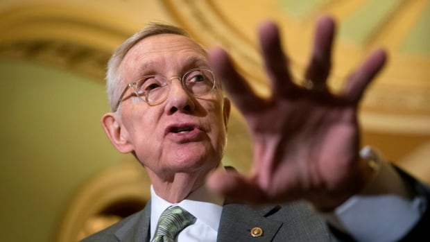 U.S. Senate Minority Leader Harry Reid of Nevada speaks with reporters on Capitol Hill in Washington, Wednesday, Jan. 20, 2016, before Senate Democrats blocked legislation  that would crack down on Syrian and Iraqi refugees entering the U.S.