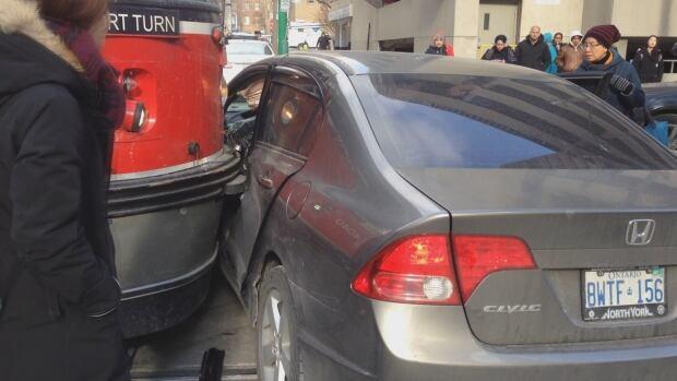 close up streetcar vs vehicle
