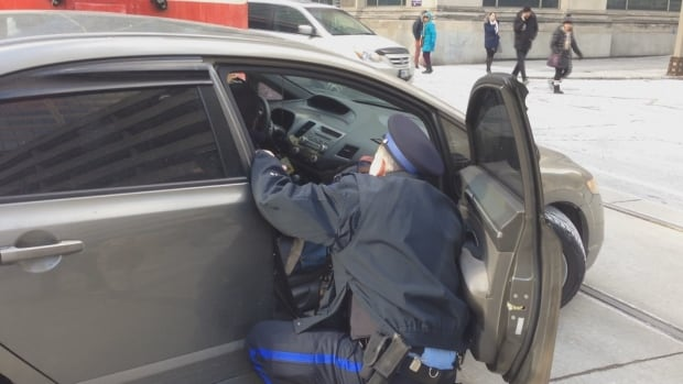 Toronto parking enforcement with victim streetcar vs. car