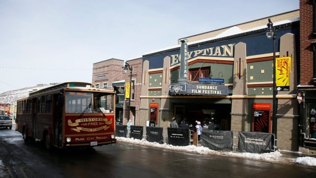 A trolley passes the marquee at the Egyptian Theatre on Main Street in Park City, Utah on Thursday, as the 2016 Sundance Film Festival gets underway.