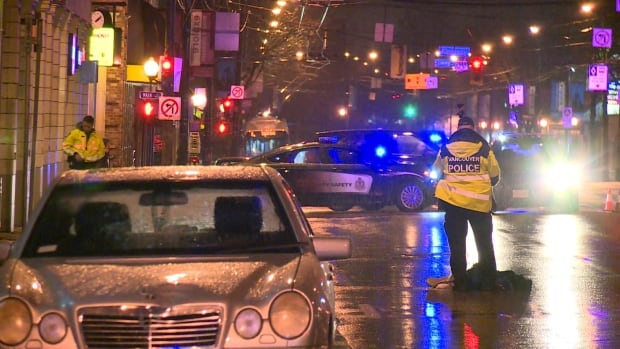 Vancouver police officers investigate after a man was struck by a motorist Thursday night.