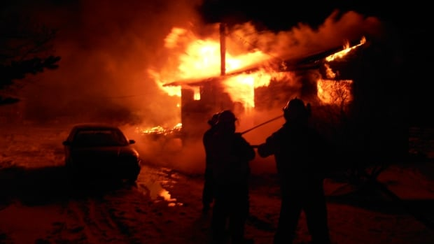 Two people escaped through a bedroom window, following a fire in Bunyan's Cove early Friday morning.